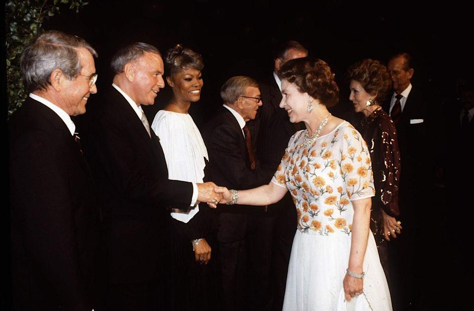 <p>What does Ol' Blue Eyes wear when he meets the Queen? Typical of the crooner, Frank Sinatra wore his best tailored suit for the event at the 20th Century Fox studios in 1983.</p>