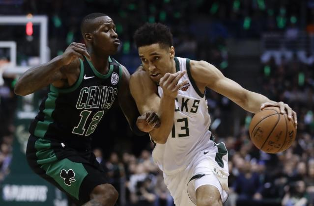 Milwaukee Bucks' Malcolm Brogdon tries to drive past Boston Celtics' Terry Rozier during the first half of Game 4 of an NBA basketball first-round playoff series Sunday, April 22, 2018, in Milwaukee. (AP Photo/Morry Gash)