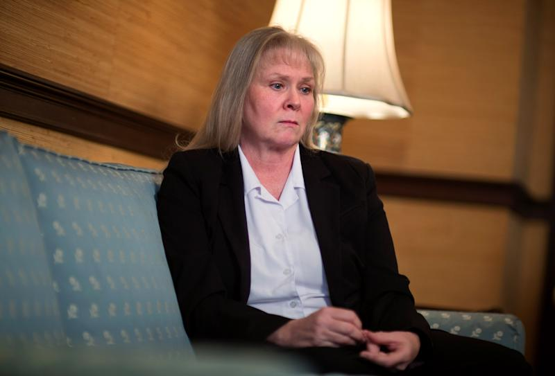 Lynn Waits, 55, of Covington, Ga., sits down to tell her story about complications from having surgical mesh placed in her pelvic cavity, during an interview in her attorney's office, Monday, Jan. 28, 2013, in Athens, Ga. Waits is one of the thousands of women nationwide who have sued manufacturers of the surgical mesh claiming they've suffered severe complications and intense physical pain when the flexible plastic mesh hardened inside their bodies. (AP Photo/David Goldman)