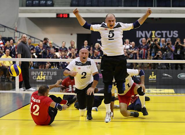 The Sitting Volleyball team from Georgia reacts as they score the final point to win the gold medal at the Invictus Games in Toronto, Ontario, Canada September 27, 2017. REUTERS/Fred Thornhill