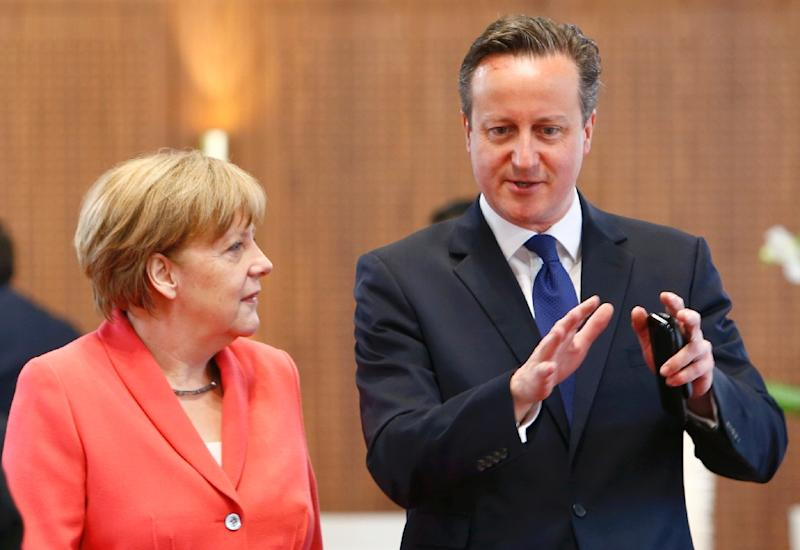 German Chancellor Angela Merkel (L) chats with British Prime Minister David Cameron prior to the second working session of a G7 summit at the Elmau Castle near Garmisch-Partenkirchen, southern Germany, on June 8, 2015 (AFP Photo/Michaela Rehle)