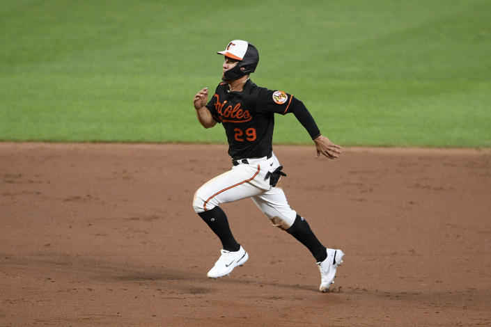 Baltimore Orioles' Ramon Urias runs to third on a throwing error by Washington Nationals relief pitcher Wander Suero on a pickoff attempt during the sixth inning of a baseball game Friday, July 23, 2021, in Baltimore. (AP Photo/Nick Wass)