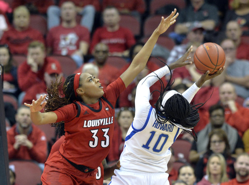 Louisville forward Bionca Dunham (33) attempts to block the shot of Kentucky guard Rhyne Howard (10) during the second half of an NCAA college basketball game in Louisville, Ky., Sunday, Dec. 9, 2018. (AP Photo/Timothy D. Easley)