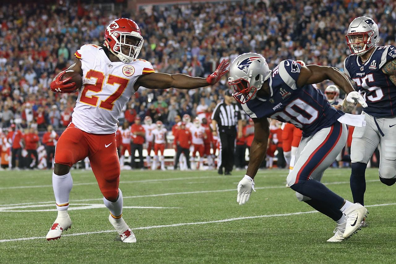 <p>Kareem Hunt #27 of the Kansas City Chiefs stiff arms Duron Harmon #30 of the New England Patriots as he runs for a 4-yard rushing touchdown during the fourth quarter against the New England Patriots at Gillette Stadium on September 7, 2017 in Foxboro, Massachusetts. (Photo by Maddie Meyer/Getty Images) </p>