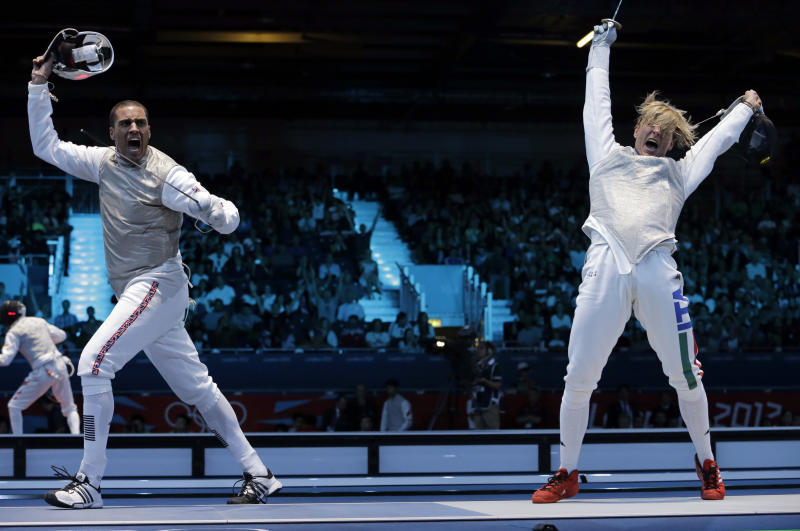 James-Andrew Davis of Great Britain competes against Valerio Aspromonte of Italy, right, during the men's foil team fencing competition at the 2012 Summer Olympics, Sunday, Aug. 5, 2012, in London. Italy beat Great Britain to advance. (AP Photo/Dmitry Lovetsky)