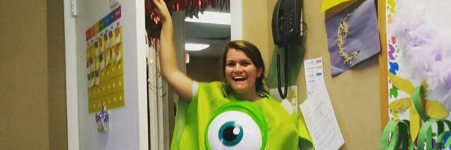Nicole in her classroom wearing a funny Monsters Inc costume.