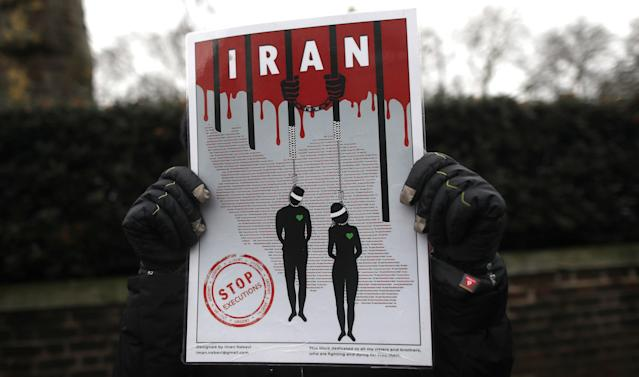 <p>Opponents of Iranian President Hassan Rouhani hold a protest outside the Iranian embassy in west London, Britain, Jan. 2, 2018. (Photo: Simon Dawson/Reuters) </p>