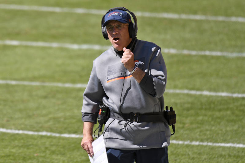 Vic Fangio yells out to his team, without a mask.