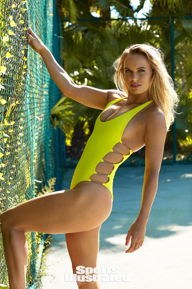 <p>The blonde also posed in a more familiar setting — on the court. This time in a one-piece, bright yellow suit that allowed her to showcase her athletic physique. (Photo: Emmanuelle Hauguel/Sports Illustrated) </p>
