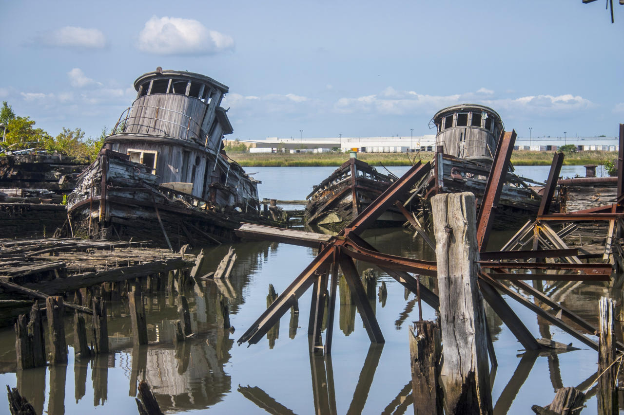 <p>Making your way out to photograph these old two old wooden tugboats is very dangerous. The wooden piers have been the victim of fire and age. The spikes used to build the piers are visible. (Photo: Gordon Donovan/Yahoo News) </p>
