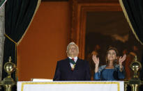 Mexican President Andres Manuel Lopez Obrador and his wife Beatriz Gutierrez Muller watch the fireworks during Mexico's Independence Day celebrations at the Zocalo in Mexico City, Wednesday, Sept. 15, 2021. (AP Photo/Fernando Llano)