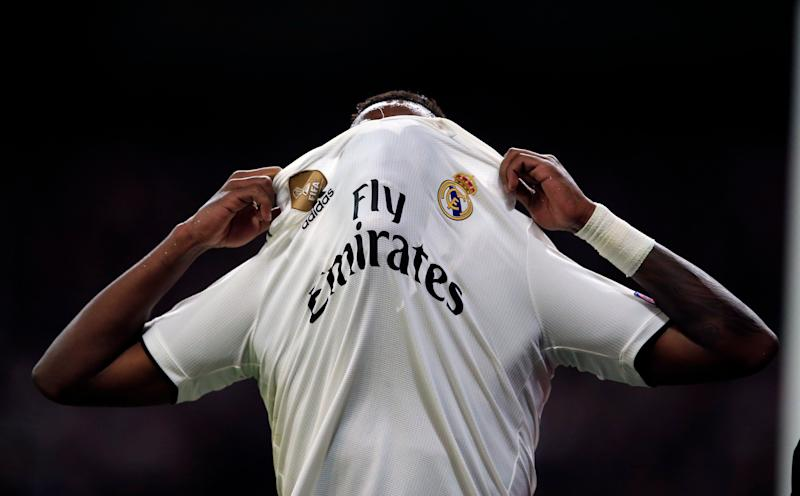The injured Real forward Vinicius Junior reacts during the Champions League round of 16 second leg soccer match soccer match between Real Madrid and Ajax at the Santiago Bernabeu stadium in Madrid, Tuesday, March 5, 2019. (AP Photo/Bernat Armangue)