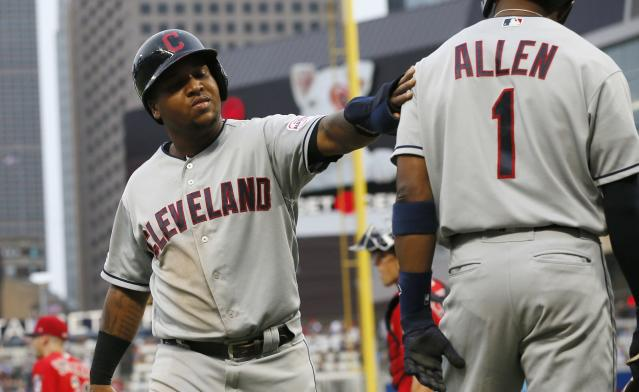 Cleveland Indians' Jose Ramirez, left, scores on a double by Franmil Reyes off Minnesota Twins pitcher Devin Smeltzer during the second inning of a baseball game Friday, Aug. 9, 2019, in Minneapolis. (AP Photo/Jim Mone)