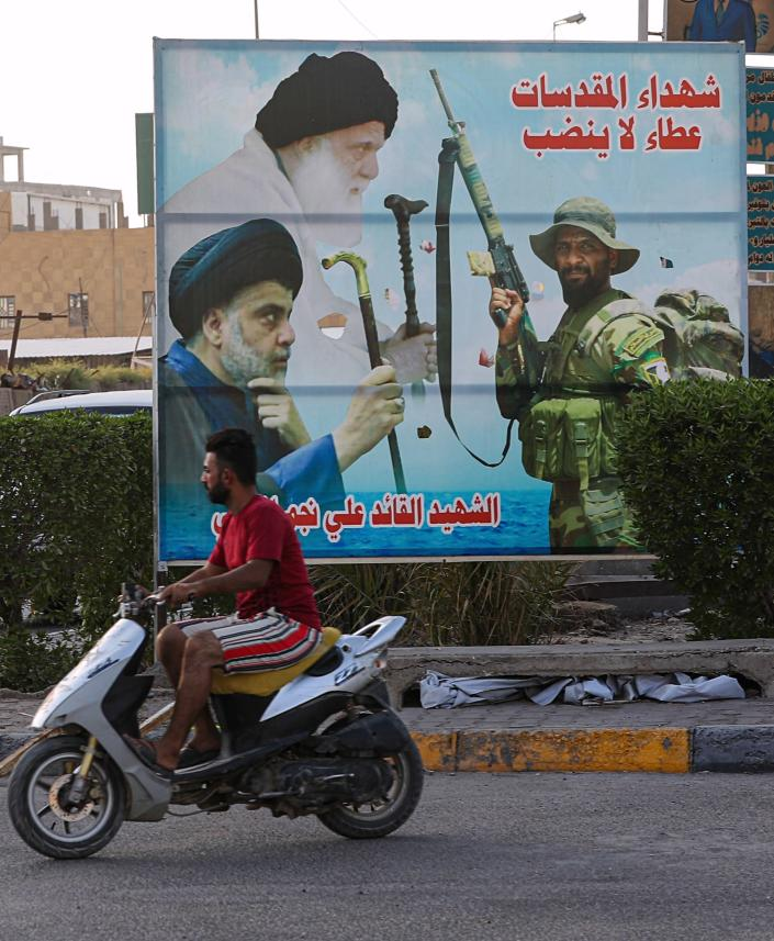 In this Wednesday, Sept. 18, 2019 photo, a billboard shows Shiite spiritual leaders, and a volunteer fighter from the Iran-backed Popular Mobilization Forces killed in Iraq fighting Islamic State militants, in Baghdad, Iraq. As the United States and Israel step up their efforts to contain Iran, countries in Tehran's orbit are feeling the heat. Through suffocating economic sanctions or on the ground via precision military strikes, Iranian-backed militias in Lebanon, Syria and Iraq are being targeted, putting their governments in the crosshairs of the escalating confrontation and raising the prospect of open conflict. Nowhere is that being felt more than in Iraq, where powerful Shiite militias tied to Iran are increasingly challenging the authority of the Iraqi government. (AP Photo/Nabil al-Jurani)