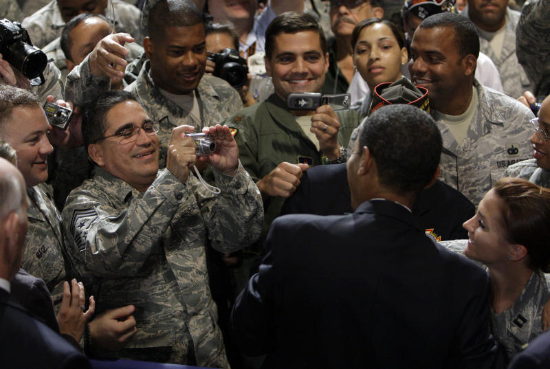 FILE - In this Aug. 17, 2009 file photo, President Barack Obama poses for a picture after speaking at the Veterans of Foreign Wars National Convention in Phoenix. The far-flung swing states that have the most sway in the presidential election have something else in common - a large share of military veterans who are getting special attention from the fiercely dueling campaigns.  In a White House campaign this hard-fought, no interest group can be ignored. But veterans are an especially prized group since so many live in battlegrounds including Colorado, Florida, New Hampshire, Nevada, North Carolina and Virginia.  (AP Photo/Alex Brandon, File)