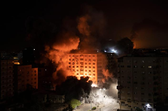 Smoke billows from Israeli airstrikes at a residential building in Gaza City on May 12.