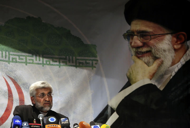 Under portrait of the Iranian supreme leader Ayatollah Ali Khamenei, presidential candidate Saeed Jalili, Iran's top nuclear negotiator, speaks during his campaign rally attended by his female supporters, in Tehran, Iran, Wednesday, May 29, 2013. Iran will hold its 11th presidential elections after 1979 Islamic Revolution, on June 14. (AP Photo/Vahid Salemi)