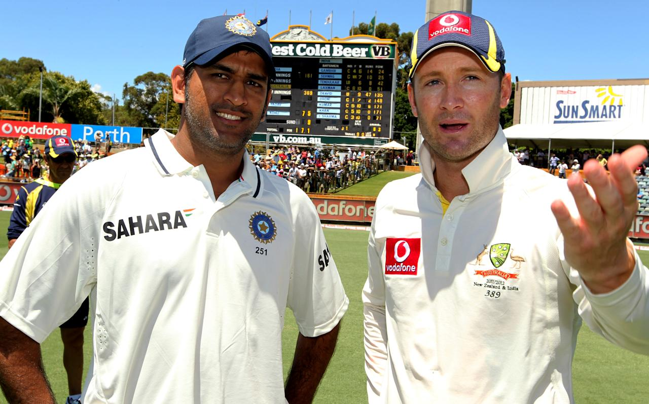 Indian captain MS Dhoni (L) and Australian captain Michael Clarke (R) chat after Australia won the third cricket Test match by an innings and 37 runs in the Border-Gavaskar Trophy Series at the WACA ground in Perth on January 15 2012. IMAGE STRICTLY RESTRICTED TO EDITORIAL USE-STRICTLY NO COMMERCIAL USE AFP PHOTO/Tony ASHBY (Photo credit should read TONY ASHBY/AFP/Getty Images)