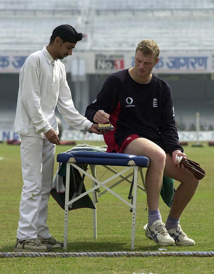 27 Jan 2002:  Andrew Flintoff of England signs an autograph during the England nets session at Green Park, Kanpur , India. DIGITAL IMAGE. Mandatory Credit: Tom Shaw/Getty Images