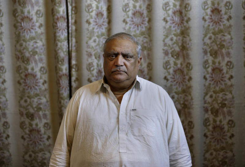 "Professor Mohammad Ismail, father of a Pakistani human rights activist Gulalai Ismail, poses for photograph at his home in Islamabad, Pakistan, Thursday, Oct. 17, 2019. A dozen plainclothes Pakistani security forces attempted to raid the former home of Gulalai Ismaila who recently fled to the United States seeking asylum. Gulalai's elderly parents say they were ordered to come outside ""just to talk,"" but refused. Raids like the one early Thursday in the capital of Islamabad are part of an expanding push by Pakistan's security services to crack down on anyone who voices criticism of their activities. (AP Photo/Anjum Naveed)"