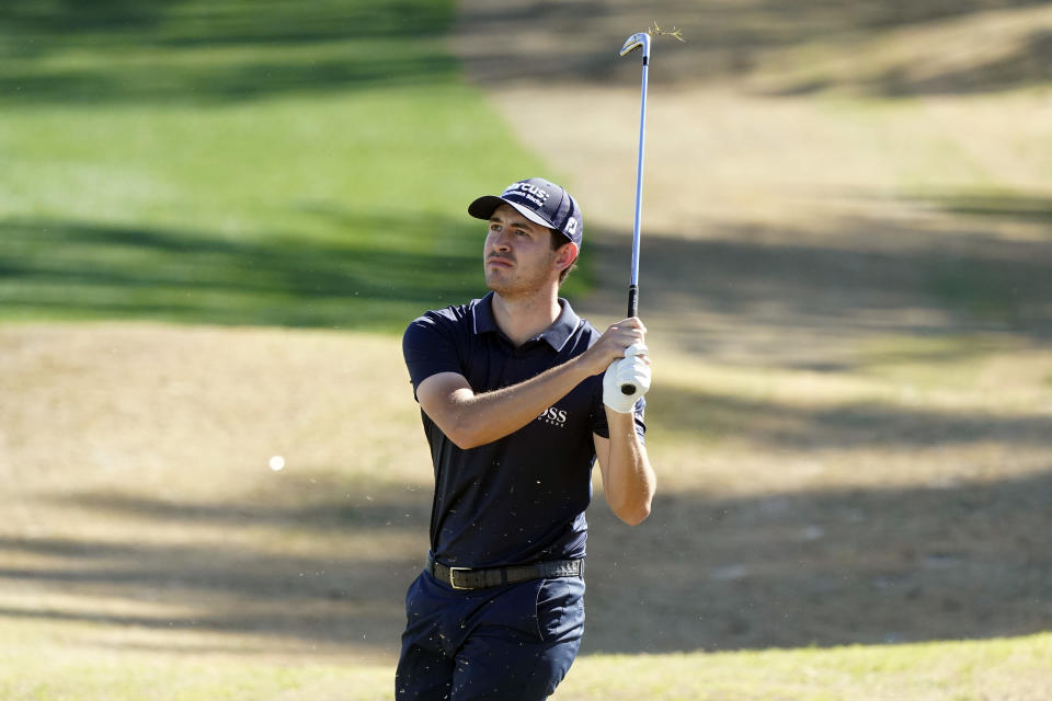 Patrick Cantlay hits from a bunker off the 18th fairway during the first round of The American Express golf tournament on the Nicklaus Tournament Course at PGA West, Thursday, Jan. 21, 2021, in La Quinta, Calif. (AP Photo/Marcio Jose Sanchez)