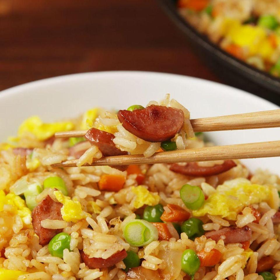 """<p>Trust us, it's better than it sounds.</p><p>Get the <a href=""""https://www.delish.com/uk/cooking/recipes/a29982199/hot-dog-fried-rice-recipe/"""" rel=""""nofollow noopener"""" target=""""_blank"""" data-ylk=""""slk:Hot Dog Fried Rice"""" class=""""link rapid-noclick-resp"""">Hot Dog Fried Rice</a> recipe.</p>"""
