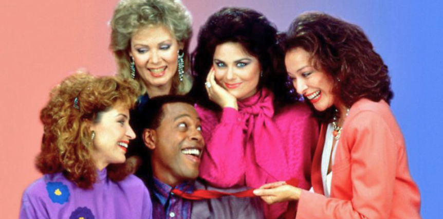 """<p>Throughout seven seasons, viewers came to know and love the cast of <em><a href=""""https://www.amazon.com/Designing-Women-Season-Dixie-Carter/dp/B001O4KBNM/"""" target=""""_blank"""">Designing Women</a></em>, starring Dixie Carter, Delta Burke, Annie Potts, Jean Smart, and Meshach Taylor. With talks of a <a href=""""https://www.hollywoodreporter.com/live-feed/designing-women-tv-revival-works-1105025"""" target=""""_blank""""><em>Designing Women</em> reboot</a> in the works, loyal fans of the Sugarbakers & Associates office can't help but wonder what happened to the original cast members, bringing entertainment into homes across America from 1986 to 1993. Whether you were a fan of Southern belle Julia Sugarbaker or laughed along with spunky Mary Jo Shively, the actresses <em>and</em> actor have come a long way since their interior designing days in Atlanta.<br></p>"""