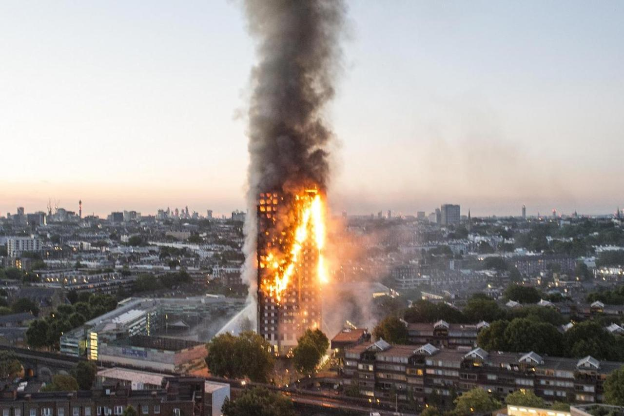 <p>A massive, deadly fire burns at the Grenfell Tower apartment block in London, England on June 14, 2017. The fire claimed 72 lives and left hundreds of people homeless. (Photo from Evening Standard) </p>