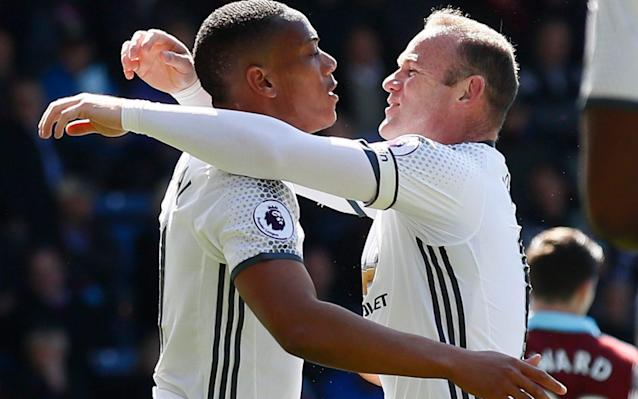<span>Anthony Martial and Wayne Rooney celebrate the Frenchman's 21st-minute opener at Turf Moor</span> <span>Credit: Reuters </span>