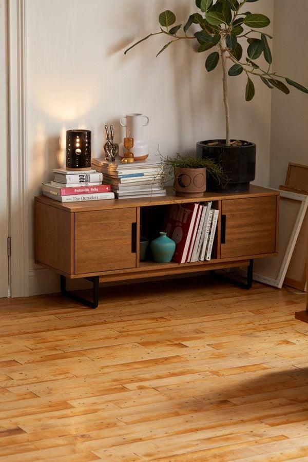 """<p>You can use this <a href=""""https://www.popsugar.com/buy/Harvey-Credenza-483346?p_name=Harvey%20Credenza&retailer=urbanoutfitters.com&pid=483346&price=499&evar1=casa%3Aus&evar9=46528352&evar98=https%3A%2F%2Fwww.popsugar.com%2Fhome%2Fphoto-gallery%2F46528352%2Fimage%2F46530405%2FHarvey-Credenza&list1=shopping%2Cfurniture%2Csmall%20space%20living%2Cliving%20rooms%2Chome%20shopping&prop13=api&pdata=1"""" rel=""""nofollow"""" data-shoppable-link=""""1"""" target=""""_blank"""" class=""""ga-track"""" data-ga-category=""""Related"""" data-ga-label=""""https://www.urbanoutfitters.com/shop/harvey-credenza?category=furniture&amp;color=020&amp;type=REGULAR"""" data-ga-action=""""In-Line Links"""">Harvey Credenza</a> ($499) in a corner or as a media console.</p>"""