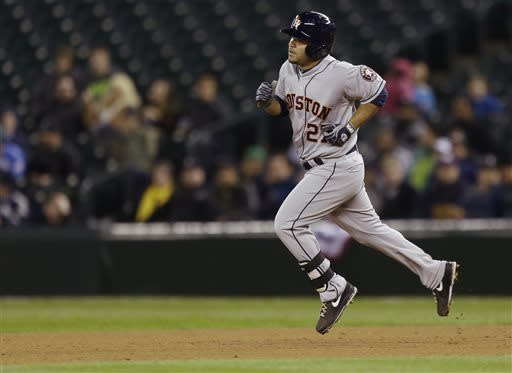 Houston Astros' Jose Altuve runs from first to second after he hit a two-run home run against the Seattle Mariners, in the fourth inning of a baseball game, Tuesday, April 9, 2013, in Seattle. (AP Photo/Ted S. Warren)