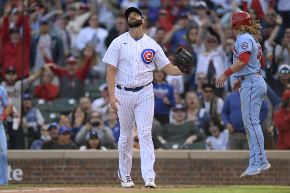 Chicago Cubs closing pitcher Tommy Nance left, reacts after St. Louis Cardinals' Harrison Bader right, scored on a wild pitch during the ninth inning of a baseball game Saturday, Sept. 25, 2021, in Chicago. (AP Photo/Paul Beaty)