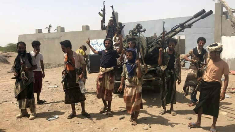 Yemeni pro-government forces backed by United Arab Emirates troops gather on the outskirts of the rebel-held port city of Hodeida on June 18, 2018 in readiness to advance into the city's battleground airport