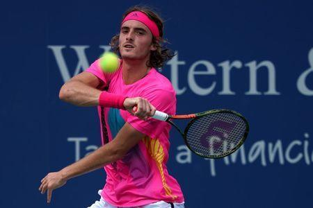 FILE PHOTO: Aug 14, 2018; Mason, OH, USA; Stefanos Tsitsipas (GRE) returns a shot against David Goffin (BEL) in the Western and Southern tennis open at Lindner Family Tennis Center. Mandatory Credit: Aaron Doster-USA TODAY Sports