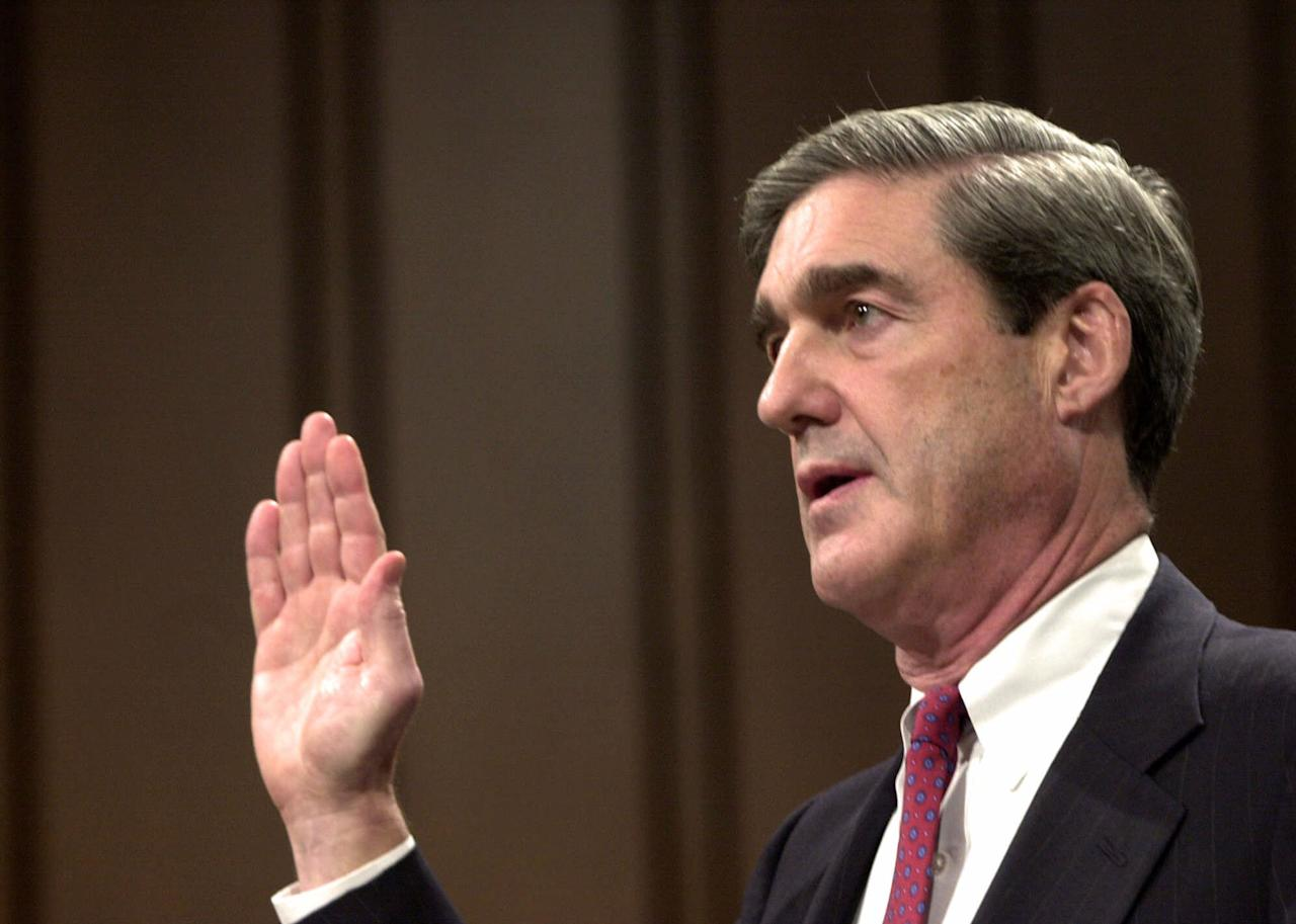 <p>Robert Mueller, President Bush's choice to become director of the FBI, is sworn in at the start of his testimony during his confirmation hearing before the Senate Judiciary Committee on Capitol Hill, Monday, July 30, 2001. (Photo: Dennis Cook/AP) </p>