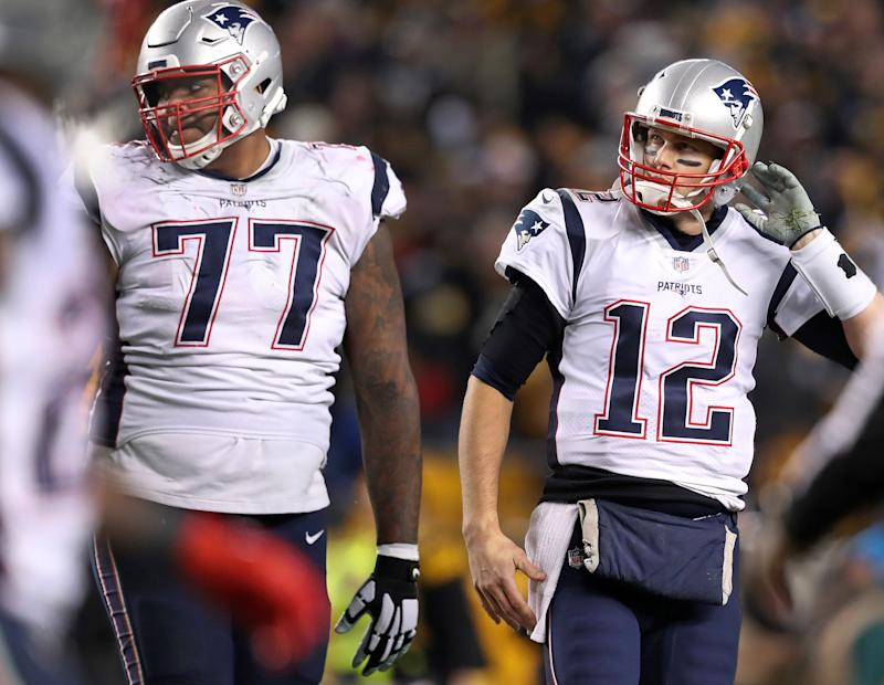Could Trent Brown (77) and quarterback Tom Brady (12) be reunited on the Las Vegas Raiders? (Photo by Jim Davis/The Boston Globe via Getty Images)