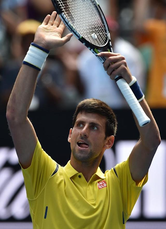 Serbia's Novak Djokovic celebrates after defeating South Korea's Chung Hyeon on day one of the Australian Open in Melbourne on January 18, 2016 (AFP Photo/Saeed Khan)