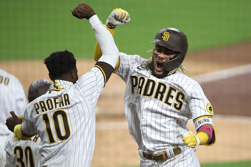 SAN DIEGO, CALIFORNIA - OCTOBER 01: Jurickson Profar #10 congratulates Fernando Tatis Jr. #23 of the San Diego Padres after his two-run homerun during the seventh inning of Game Two of the National League Wild Card Series against the St. Louis Cardinals at PETCO Park on October 01, 2020 in San Diego, California. (Photo by Sean M. Haffey/Getty Images)