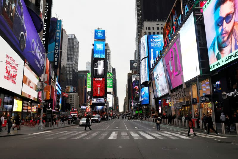FILE PHOTO: A nearly empty 7th Avenue in Times Square is seen at rush hour after it was announced that Broadway shows will cancel performances due to the coronavirus outbreak in New York