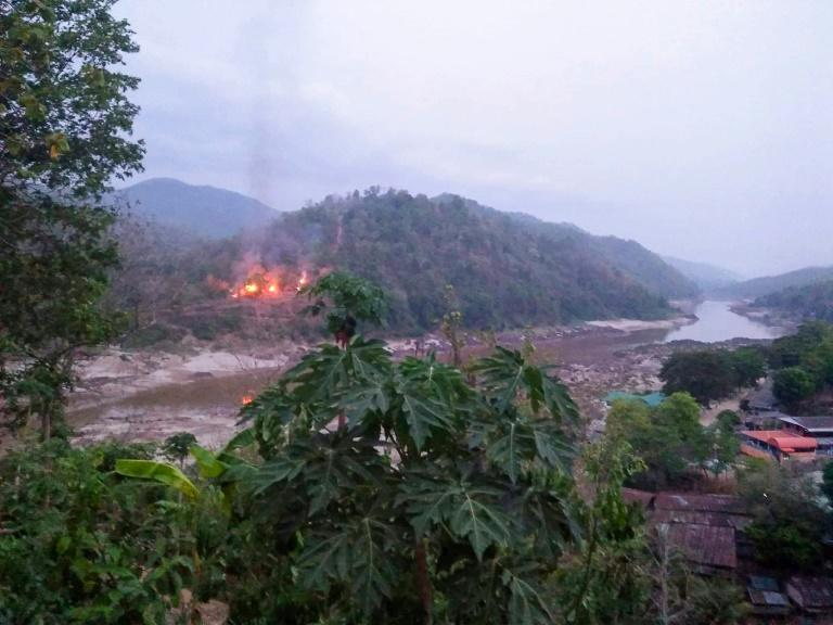 Fires burned at a Myanmar military base along the bank of the Salween river after the base was attacked and captured by the Karen National Union