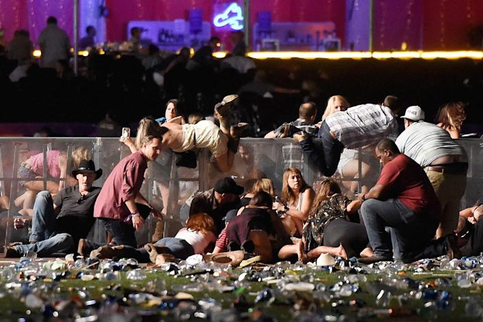 <p>OCT. 1, 2017 – People scramble for shelter at the Route 91 Harvest country music festival after apparent gun fire was heard in Las Vegas, Nevada. Stephen Paddock, a 64-year-old resident of Mesquite, Nevada, suspected of killing at least 59 people and injuring at least 527, shot himself shortly after the attack. The motive is still unknown. (Photo: David Becker/Getty Images) </p>