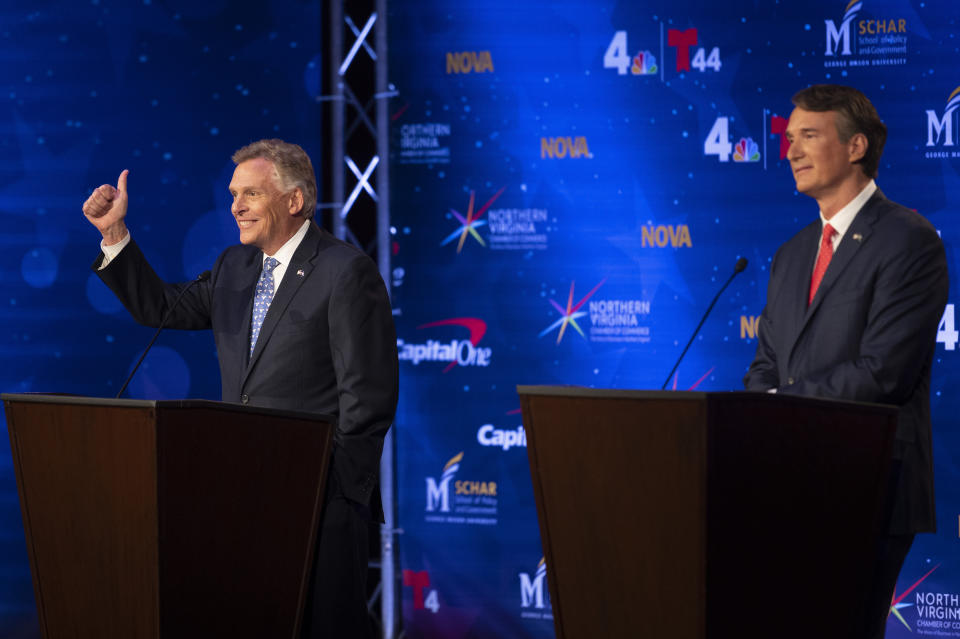 Virginia Democratic gubernatorial candidate and former Gov. Terry McAuliffe, left, and Republican challenger, Glenn Youngkin, participate in a debate at Northern Virginia Community College, in Alexandria, Va., Tuesday, Sept. 28, 2021. (AP Photo/Cliff Owen)