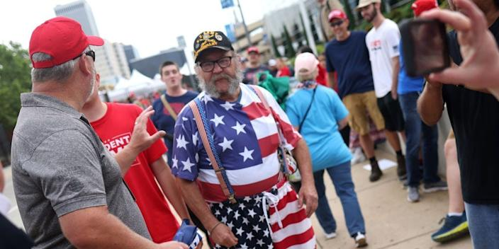 Supporters of President Donald Trump gather to attend a campaign rally at the BOK Center, June 20, 2020 in Tulsa, Oklahoma.