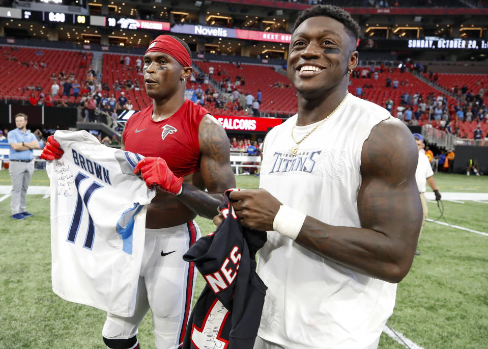 Julio Jones #11 of the Atlanta Falcons swaps jerseys with A.J. Brown #11 of the Tennessee Titans at the conclusion of an NFL game at Mercedes-Benz Stadium on September 29, 2019 in Atlanta, Georgia. (Photo by Todd Kirkland/Getty Images)