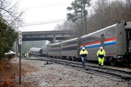 FILE PHOTO: Emergency responders are at the scene after an Amtrak passenger train collided with a freight train and derailed in Cayce, South Carolina, U.S., February 4, 2018. REUTERS/Randall Hill
