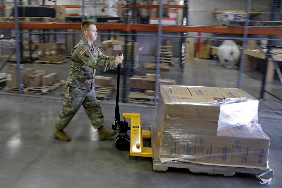 FILE - In this March 26, 2020, file photo, an Indiana National Guardsman pushes a pallet of medical supplies to be delivered in Indianapolis. An Associated Press analysis shows states spent more than $7 billion this spring buying personal protective equipment like masks, gloves and gowns as well as vital medical devices like ventilators. (AP Photo/Darron Cummings, File)