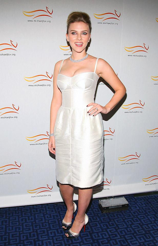 "Scarlett Johansson's unflattering D&G frock does little for her lovely figure. Her unsightly updo only makes matters worse. Stephen Lovekin/<a href=""http://www.gettyimages.com/"" target=""new"">GettyImages.com</a> - November 6, 2008"