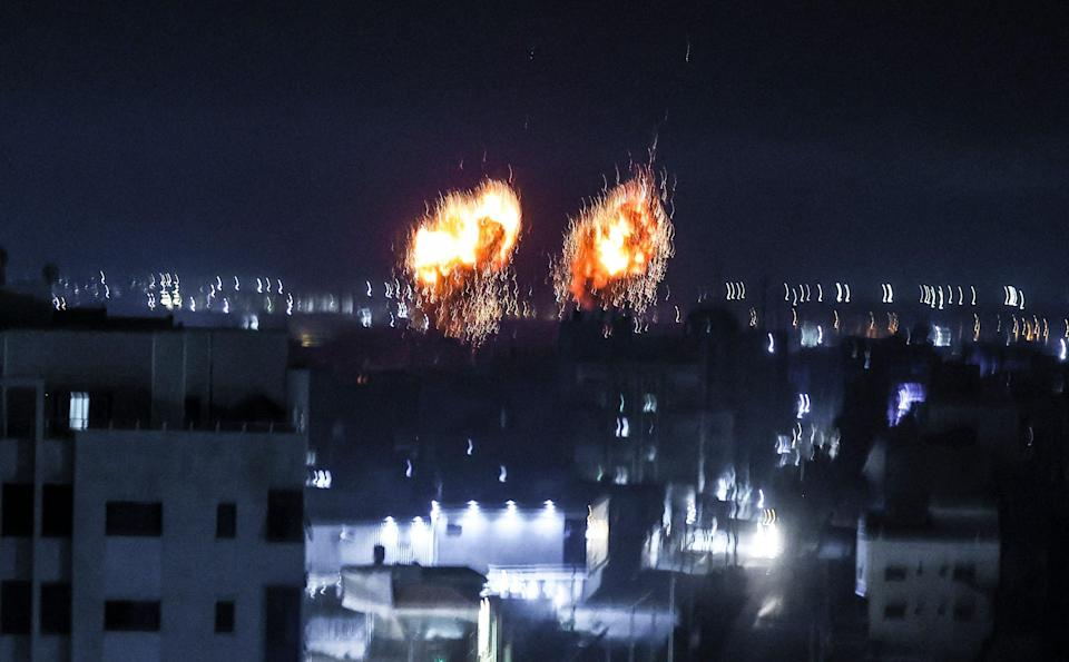 Explosions lit up the night sky about building in Gaza city as Israeli forces shelled the Palestinian enclave, in response to incendiary balloons. (AFP/Getty)