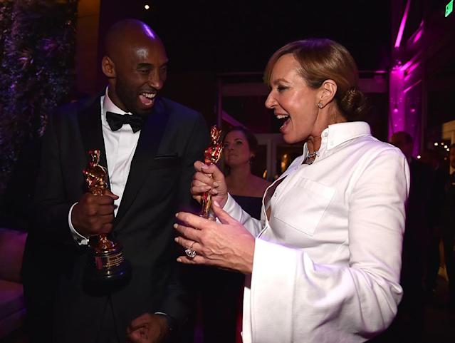 <p>One for you, one for me. The basketball star and I, Tonya actress showed off their matching statues. (Photo: Kevin Mazur/VF18/WireImage) </p>