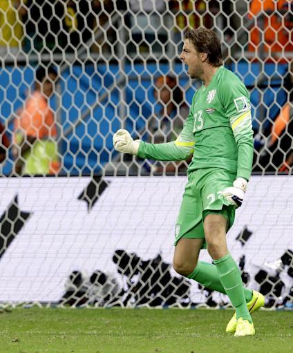 Netherlands' goalkeeper Tim Krul celebrates after saving a penalty during penalty kicks of the World Cup quarterfinal soccer match between the Netherlands and Costa Rica at the Arena Fonte Nova in Salvador, Brazil, Saturday, July 5, 2014. (AP Photo/Hassan Ammar)